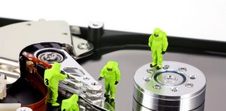 hazmat team inspecting a hard drive