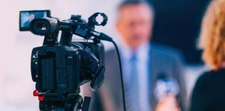 Interview. Journalist interviewing businessman